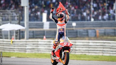 Marc Marquez celebrates winning the MotoGP world title