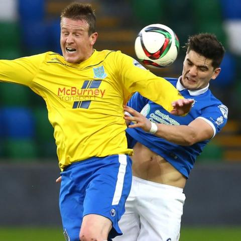 Ballymena United's Allan Jenkins in action against Jimmy Callacher during the fifth round match which Linfield won 2-1