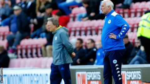 Neil Warnock and Graham Barrow on the touchline when Cardiff met Wigan