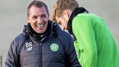 Brendan Rodgers shares a joke with Stuart Armstrong at training on Monday morning