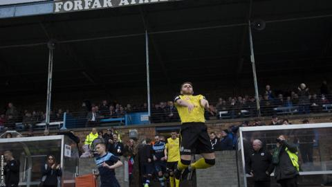 City defender Jordan Caddow leaps highest as the teams take to the pitch