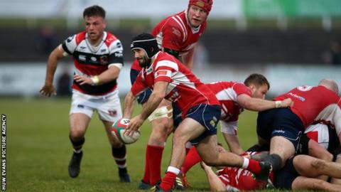 Llanelli scrum-half Gareth George gets the ball away against Pontypool