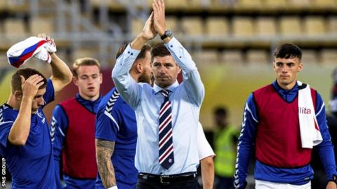 Manager Steven Gerrard applauds the 300 or so Rangers fans who travelled to Macedonia