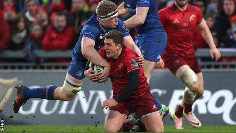 Leinster's Dan Leavy tackles Munster's Ian Keatley's at Thomond Park