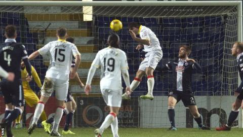 Kris Doolan heads home Thistle's second goal
