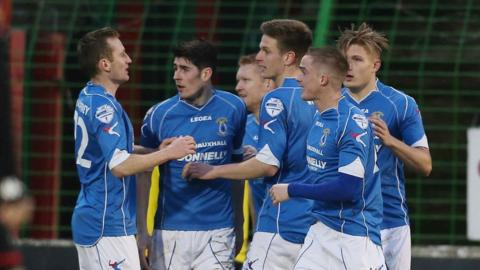 Andrew Mitchell is congratulated by his team-mates after giving Dungannon the lead against Glentoran at the Oval