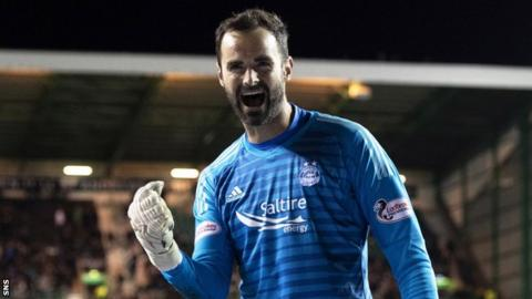 Joe Lewis celebrates beating Hibs in a quarter-final penalty shootout
