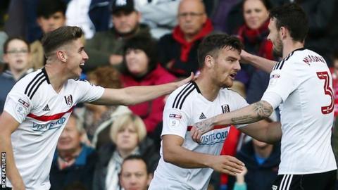 Chris Martin (centre) celebrates scoring for Fulham