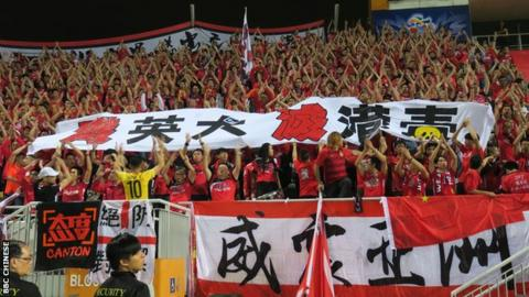 "Guangzhou Evergrande fans show a banner that reads ""Annihilate British dogs, extinguish HK independence poison"" during the match at the Mong Kok Stadium in Hong Kong, 25 Apr 2017."