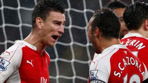 Laurent Koscielny and Santi Cazorla of Arsenal