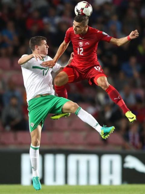 Northern Ireland's Paddy McNair is beaten to the ball by the Czech Republic's David Pavelka