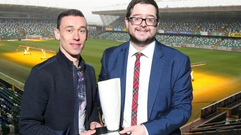 Player of the Month Paul Heatley collects his trophy from NIFWA Chair Keith Bailie