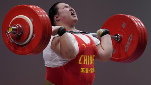 Tokyo, Japan, 7 July: Li Wenwen, of China, competes in the women's +87kg weightlifting on day two of Ready Steady Tokyo - a test event at the Tokyo International Forum for the 2020 Olympic Games. (Photo by Toru Hanai/Getty Images)