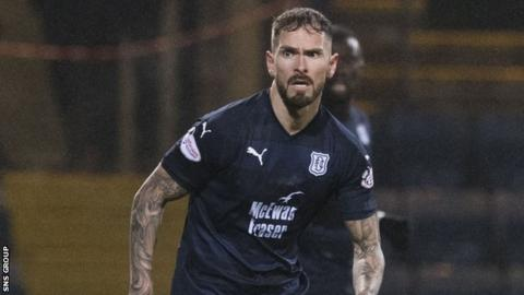 Martin Woods is staying at Dens Park