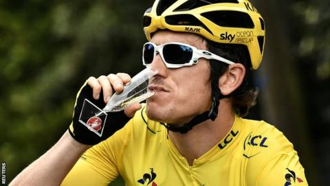 Geraint Thomas sips champagne
