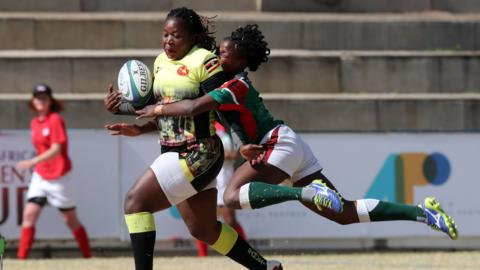 JOHANNESBURG, SOUTH AFRICA - AUGUST 13: In this handout image provided by the APO Group, Irene Nzige of Uganda tackled by Naomi Amuguni of Kenya during the Kenya v Uganda Rugby Africa Women's World Cup match at Bosman Stadium on August 13, 2019 in Johannesburg, South Africa. (Photo by APO Group via Getty Images)