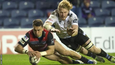 Damien Hoyland dives over for his first try of the evening