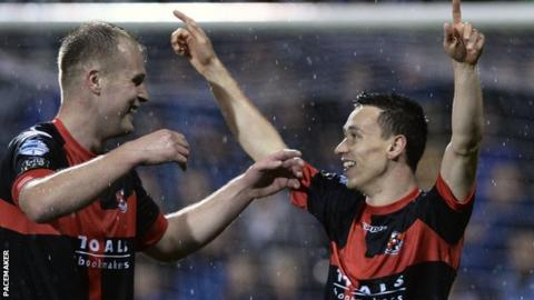 Jordan Owens congratulates a delighted Paul Heatley after the winger scores against Linfield