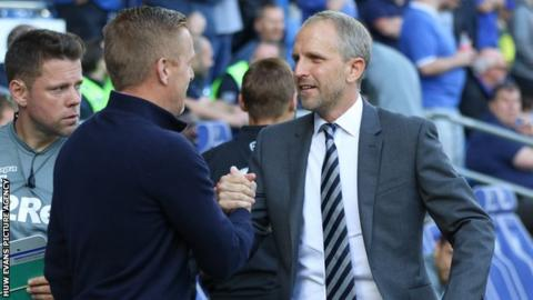 Paul Trollope and Gary Monk shake hands