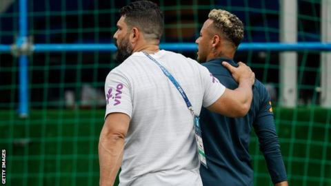 Neymar hobbles out of training