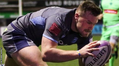 Owen Lane goes over for Blues