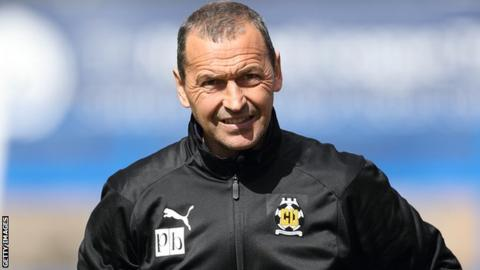 Cambridge United head coach Colin Calderwood on the sidelines