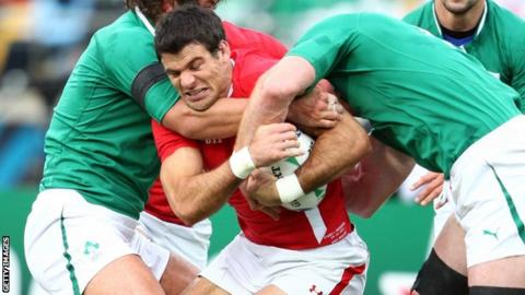 Mike Phillips is roughed-up by Ireland's pack