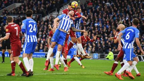 Emre Can heads Liverpool's first goal against Brighton