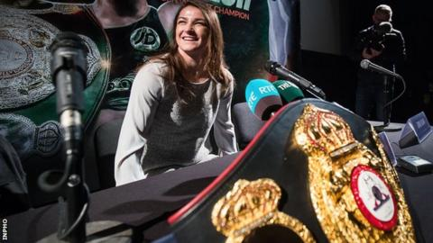 Katie Taylor kept her WBA belt close by during a homecoming press conference in Dublin on Tuesday