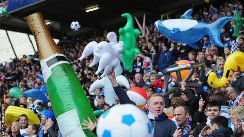 Football fans with inflatables during a match