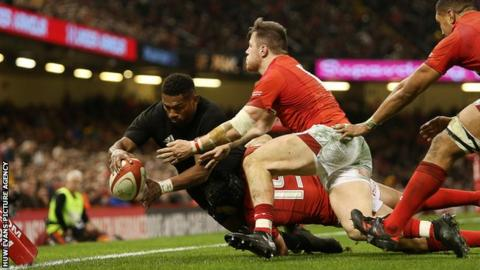 Waisake Naholo of New Zealand scores a try