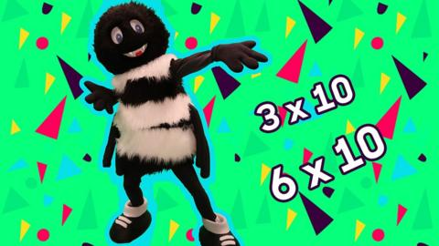 Mascot, Webster the Spider points to the sums, 3 times 10 and 6 times 10.