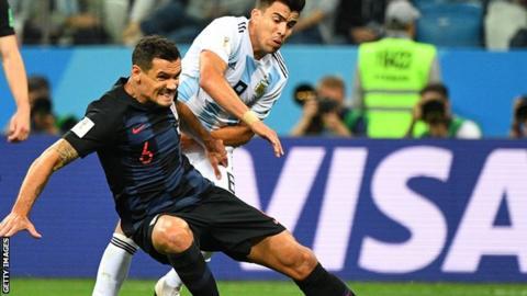 Dejan Lovren makes a tackle
