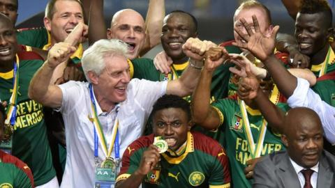 Cameroon and coach Hugo Broos celebrate their 2017 Africa Cup of Nations triumph