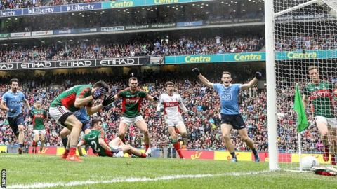 Despair for Mayo's Kevin McLoughlin as he diverts the ball into his own net in the All-Ireland final