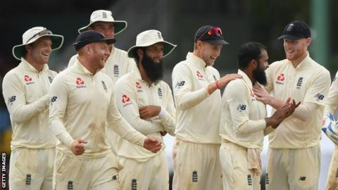 England spinner Adil Rashid is congratulated by his team-mates