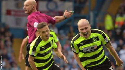 Aaron Mooy celebrates his winning goal for Huddersfield against Leeds