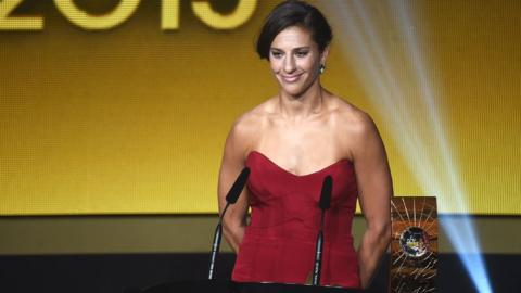 Carli Lloyd poses with the Women's World Player of the Year award