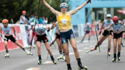 Beijing, China, 6 July: Linn Soemskar, of Sweden, celebrates after winning the women's 15.9km mass start event at the Rollerski World Cup in Beijing Olympic Park. (Photo by Xinyu Cui/Getty Images)