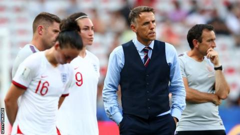 England women's boss Phil Neville, players and coaches look on after third-place play-off defeat by Sweden at the 2019 World Cup