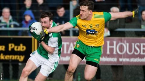 Ciaran Corrigan attempts to get past Donegal's Hugh McFadden in Letterkenny