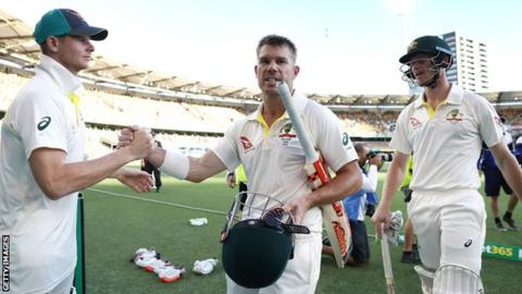 Steve Smith of Australia congratulates David Warner and Cameron Bancroft as they walk from the ground at the end of day four of the first Test of the 2017/18 Ashes Series between Australia and England.