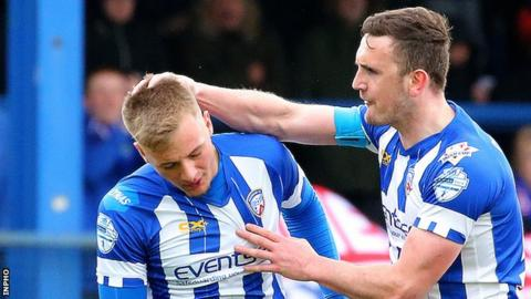 Dylan Davidson (left) celebrates scoring his only goal for Coleraine against Linfield