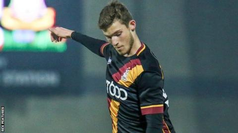 Bradford City winger Ellis Hudson looks down at the ball during an EFL Trophy game against Morecambe