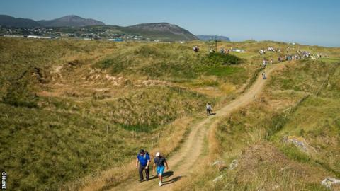 Rory McIlroy makes his way towards the fourth tee at Ballyliffin