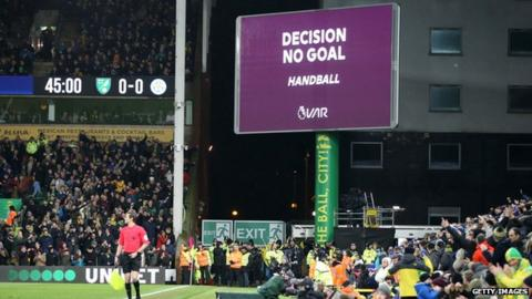 The big screen at Carrow Road displaying that a goal has been disallowed for handball following a VAR check