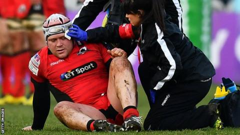 WP Nel receives treatment during his comeback for Edinburgh against Harlequins