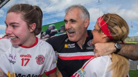 Manager of the Tyrone team, Gerry Moane, celebrates with Maria Canavan and Lycrecia Quinn after the game