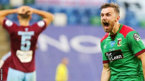 Despair for Ballymena but delight for Robbie McDaid as he celebrates his late winner