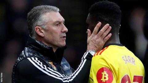 Watford manager Nigel Pearson congratulates Ismaila Sarr after the win over Manchester United